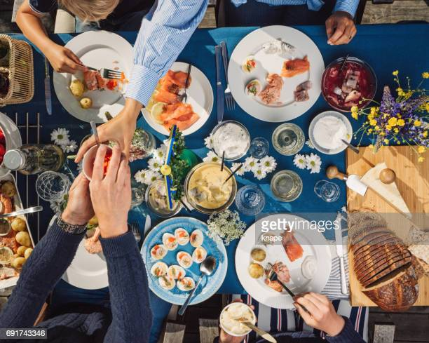 swedish summer midsommar midsummer celebration dinner party - midsommar stock pictures, royalty-free photos & images
