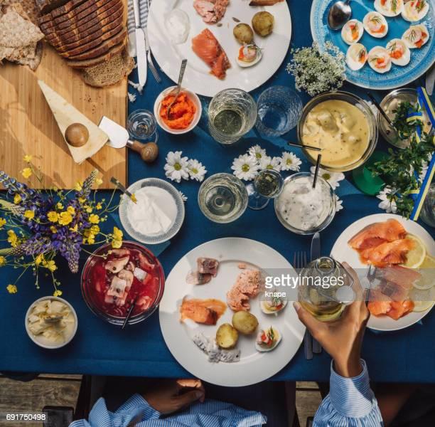swedish summer midsommar midsummer celebration dinner party - midsummer sweden stock pictures, royalty-free photos & images