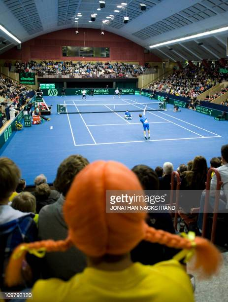 Swedish supporter dressed as Swedish fictional character Pippi longstockings, watches the Davis Cup first round doubles match between Sweden's Simon...