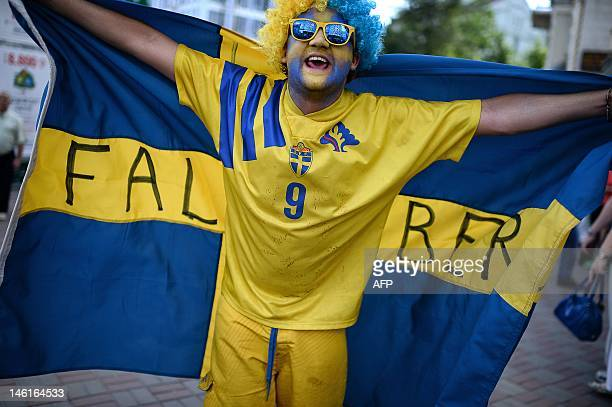 A Swedish supporter holds his national flag near Kiev Olympic Stadium before the start of the Euro 2012 football championships match Ukraine vs...