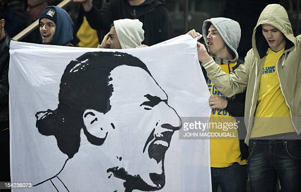 Swedish supporters display a banner featuring a likeness of Swedish forward Zlatan Ibrahimovic after Sweden's last minute equalizer of the FIFA World...
