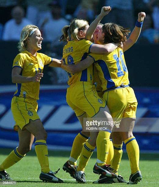 Swedish team members celebrate a goal by teammate Hanna Ljungberg during their FIFA 2003 Women''s World Cup final match against Germany 12 October...