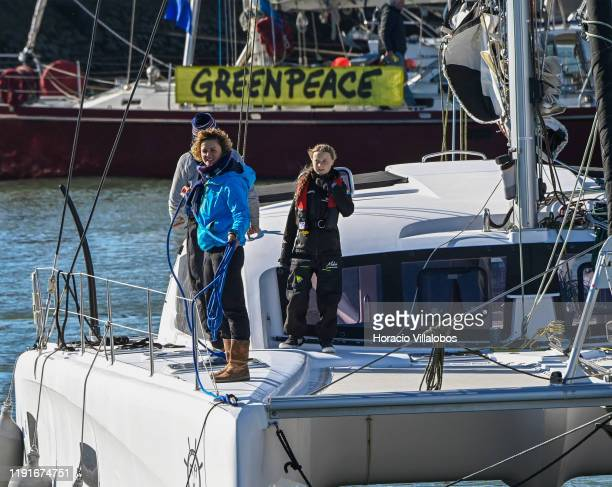 Swedish teen climate activist Greta Thunberg waves to supporters while arriveing in Santo Amaro Recreation dock on December 03, 2019 in Lisbon,...