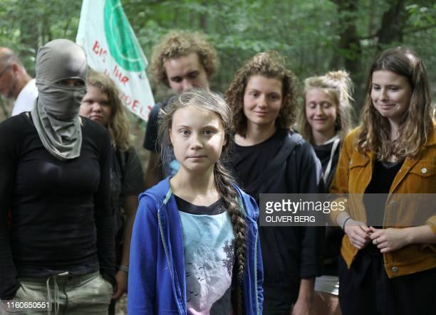 Swedish teenage climate campaigner Greta Thunberg stands next to German climate activists Luisa Neubauer from the German Fridays for Future movement...