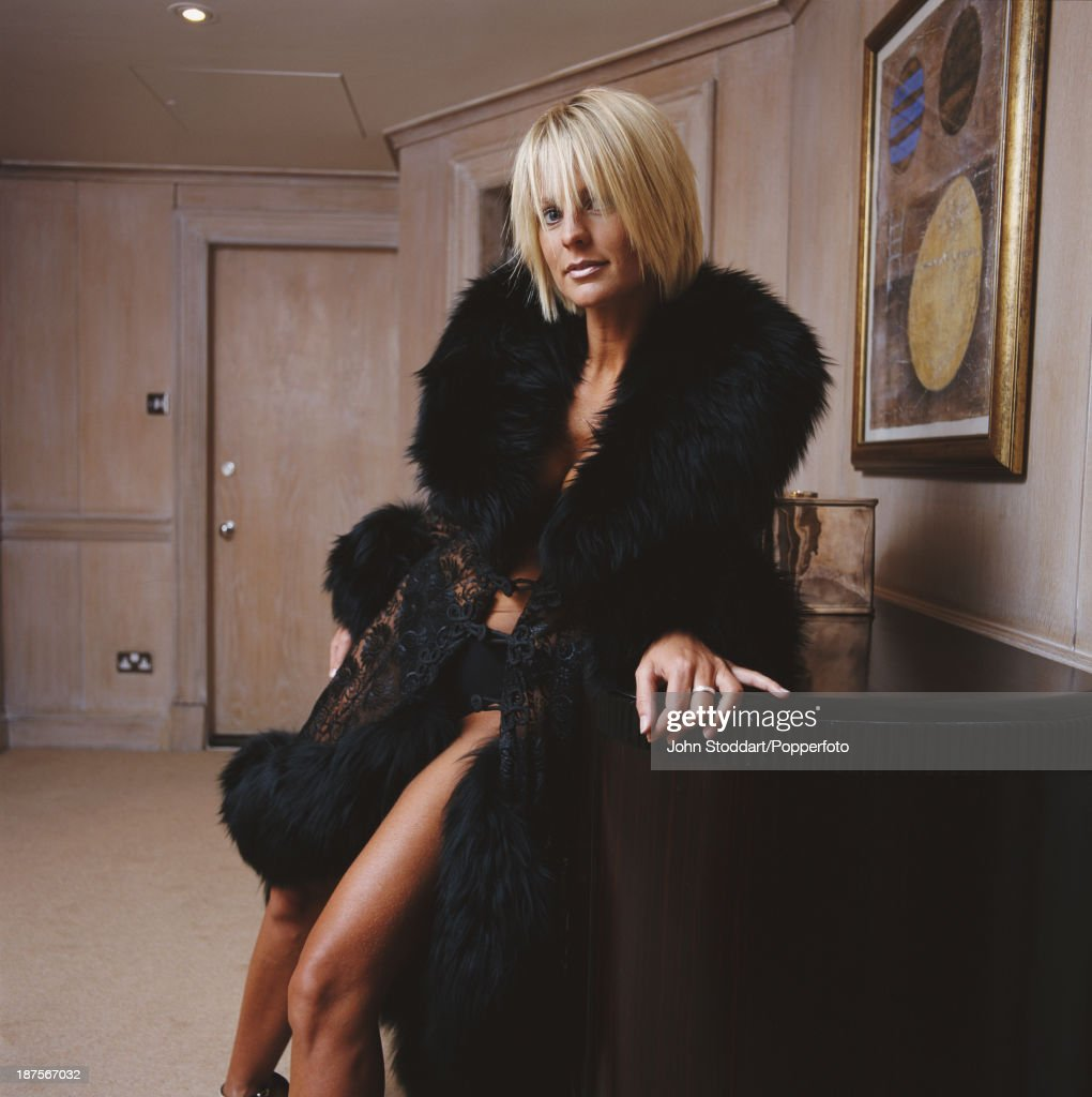 Swedish television presenter Ulrika Jonsson poses in a fur trimmed coat, 1998.
