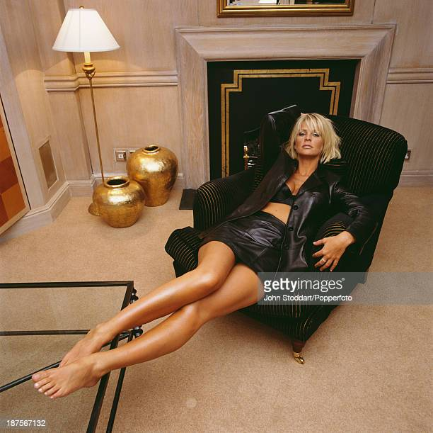 Swedish television presenter Ulrika Jonsson poses in an armchair 1998