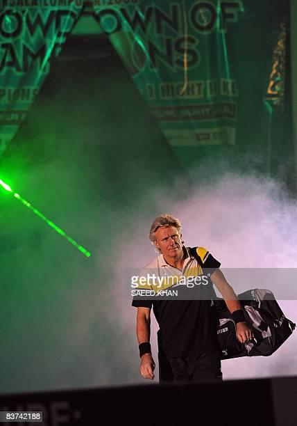 Swedish tennis legend Bjorn Borg enters the court prior an exhibition match against US John McEnroe during on November 18 in Kuala Lumpur. McEnroe...