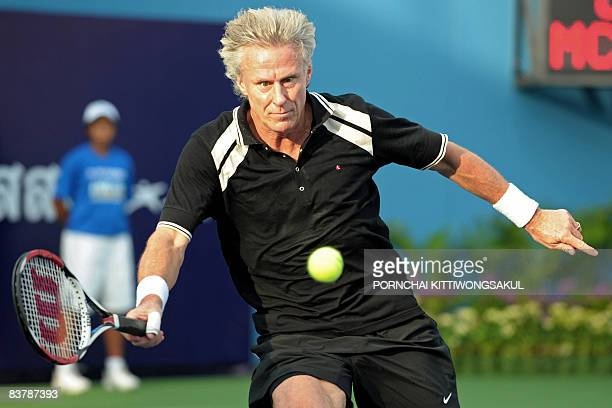 Swedish tennis legend Bjorn Borg eyes a return during an exhibition match against veteran US tennis player John McEnroe in Bangkok on November 22...