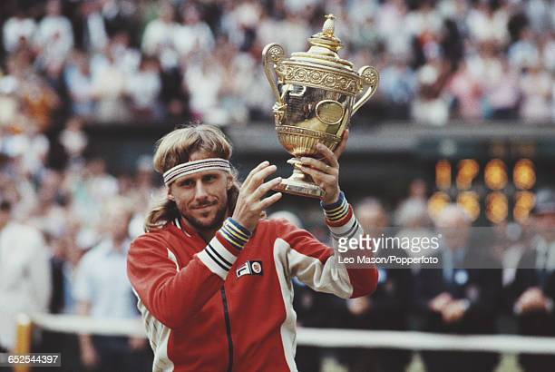 Swedish tennis player Bjorn Borg holds up the Gentlemen's Singles Trophy after defeating John McEnroe of United States16 75 63 67 86 in the final of...