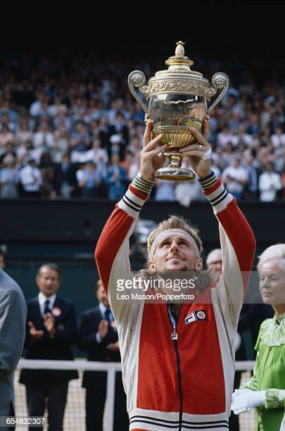 Swedish tennis player Bjorn Borg holds up the Gentlemen's Singles Trophy after defeating Roscoe Tanner to win the final of the Men's Singles...