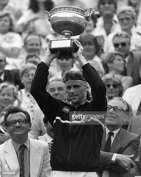 Swedish tennis player Bjorn Borg holds up the trophy after winning the French Open singles title. Original Publication: People Disc - HF0714