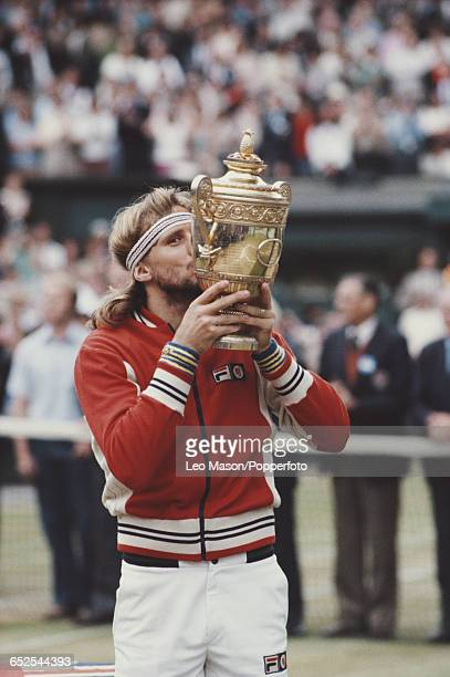 Swedish tennis player Bjorn Borg kisses the Gentlemen's Singles Trophy after defeating John McEnroe of United States16 75 63 67 86 in the final of...