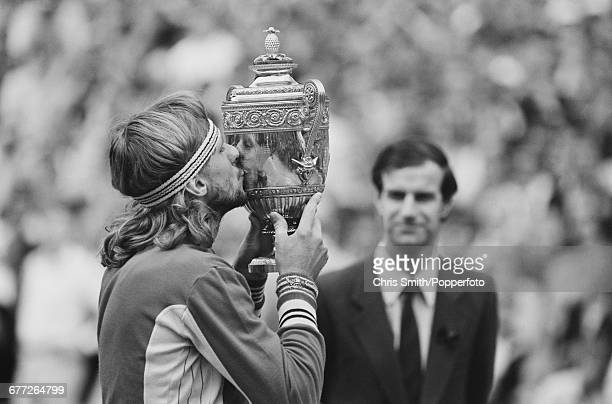 Swedish tennis player Bjorn Borg kisses the Gentlemen's Singles Trophy after defeating John McEnroe of United States 16 75 63 67 86 in the final of...
