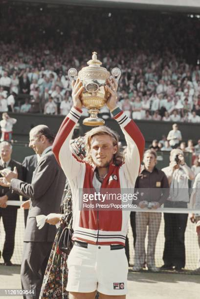 Swedish tennis player Bjorn Borg lifts up the Gentlemen's Singles Trophy after winning the final of the Men's Singles tournament against Jimmy...