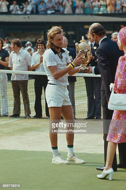 Swedish tennis player Bjorn Borg pictured being presented with the Gentlemen's Singles Trophy by Prince Edward Duke of Kent and Katharine Duchess of...