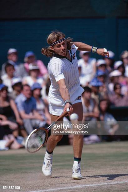 Swedish tennis player Bjorn Borg pictured in action competing to progress and win the final of the Men's Singles tournament against Roscoe Tanner 67...