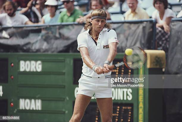 Swedish tennis player Bjorn Borg pictured in action during his fourth round match against Yannick Noah before progressing to reach the final of the...