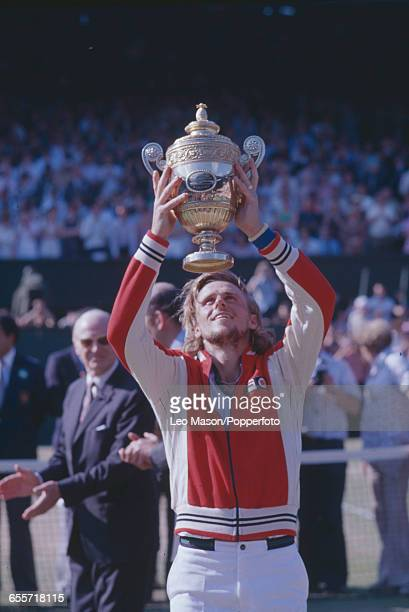 Swedish tennis player Bjorn Borg pictured lifting the Gentlemen's Singles Trophy after winning the final of the Men's Singles tournament against...