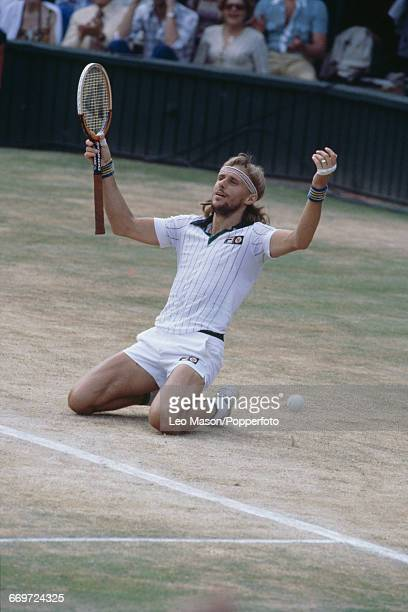 Swedish tennis player Bjorn Borg sinks to his knees and raises his arms in the air after defeating Roscoe Tanner to win the final of the Men's...