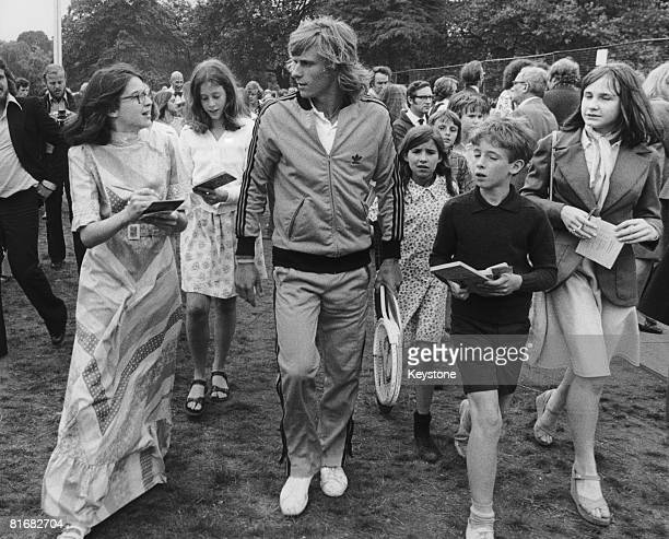 Swedish tennis player Bjorn Borg surrounded by young autograph hunters during a preWimbledon reception at the Hurlingham Club 23rd June 1974