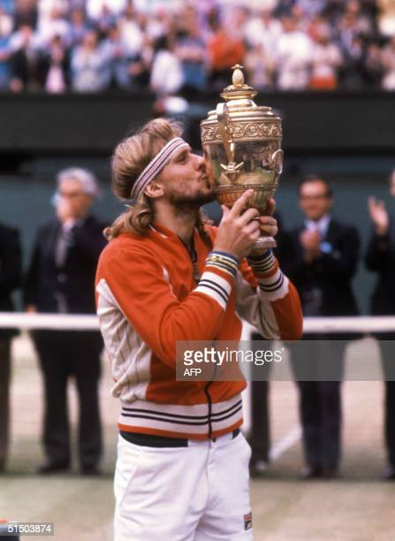 Swedish tennis player Bjrn Borg kisses the trophy after winning the Wimbledon singles championship for the fifth time in London in July 1980 Born in...