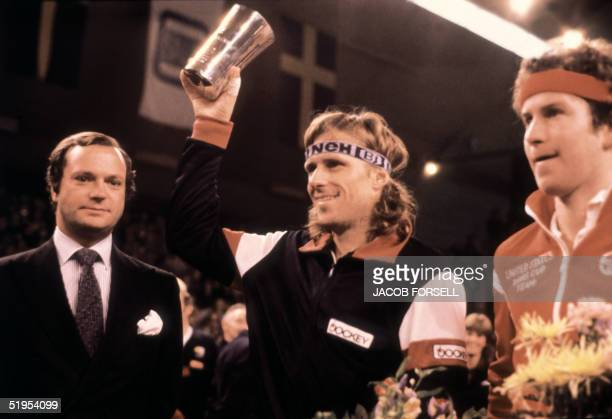 Swedish tennis player Bjrn Borg raises the trophy after his victory over John McEnroe in the Stockolm Open 10 November 1980 Born in SdertSlje Borg...