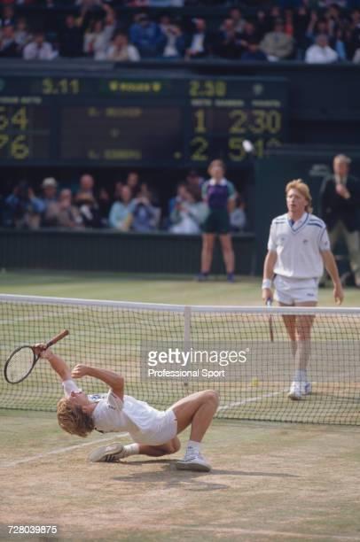 Swedish tennis player Stefan Edberg kneels back on the grass in celebration upon winning the Gentlemen's Singles Challenge Cup Trophy after defeating...