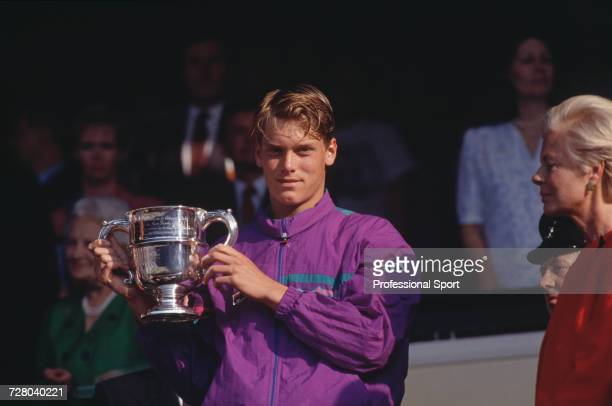 Swedish tennis player Thomas Enqvist pictured holding the trophy presented by Katharine Duchess of Kent after winning the Boys' Singles tennis...