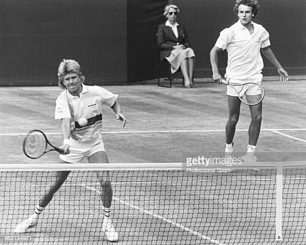 Swedish tennis players Joakim Nystrom and Mats Wilander in action in a Men's Doubles match on Centre Court at Wimbledon Tennis Championships London...