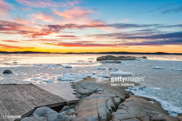 swedish winter sunset by the sea - ice floe stock pictures, royalty-free photos & images
