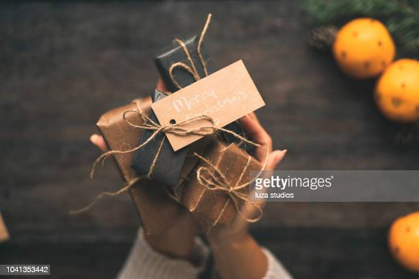 swedish woman wrapping christmas presents - country christmas stock pictures, royalty-free photos & images