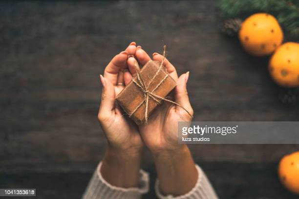 swedish woman wrapping christmas presents - giving stock pictures, royalty-free photos & images