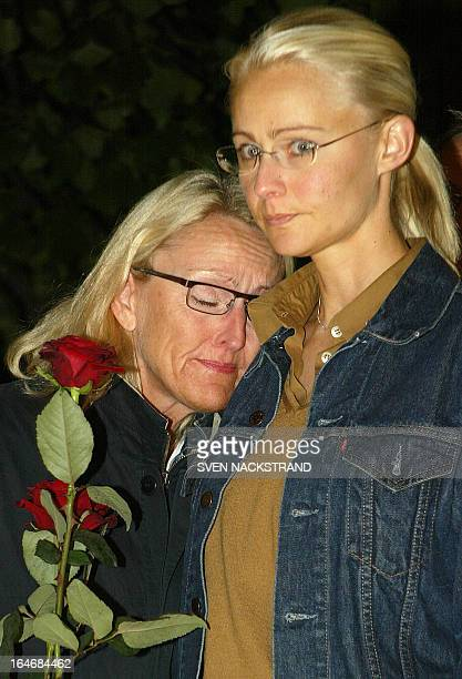 Swedish women mourn outside the Stockholm department store NK 11 September 2003 where Swedish Foreign Minister Anna Lindh was attacked Wednesday...