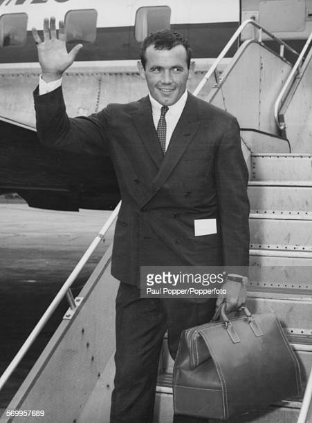 Swedish World Heavyweight champion boxer Ingemar Johansson waves as he arrives at London Airport August 22nd 1959