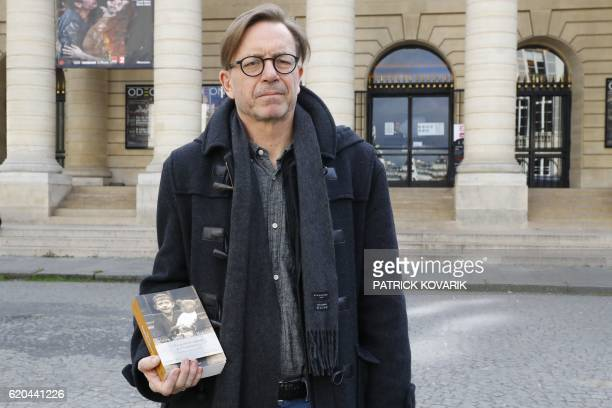 Swedish writer Steve SemSandberg poses after winning the Prix Medicis prize of the foreign novel for his book 'De utvalda' in Paris on November 2...