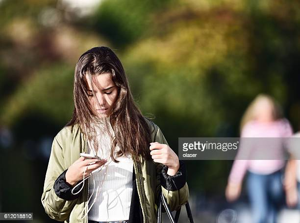 Swedish young woman, phone and headphones