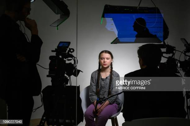 Swedish youth climate activist Greta Thunberg attends a TV interview at the World Economic Forum annual meeting on January 25 2019 in Davos eastern...