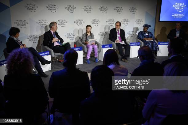 Swedish youth climate activist Greta Thunberg delivers a speech next to moderator Christiana Figueres Governor of the Bank of France Francois...
