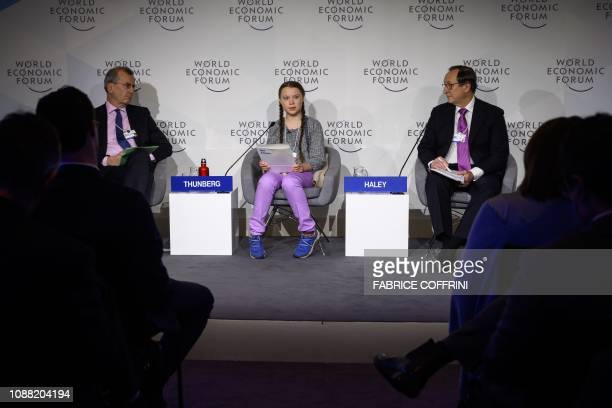 TOPSHOT Swedish youth climate activist Greta Thunberg delivers a speech between Governor of the Bank of France Francois Villeroy de Galhau and Willis...