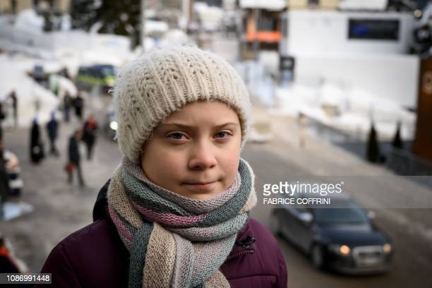 Swedish youth climate activist Greta Thunberg pose during an interview with AFP during the World Economic Forum annual meeting on January 23 2019 in...