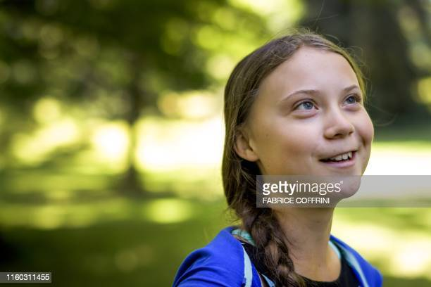 Swedish youth climate activist Greta Thunberg smiles during a meeting with Intergovernmental Panel on Climate Change representatives after the launch...