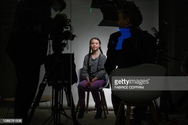 TOPSHOT Swedish youth climate activist Greta Thunberg smiles during a TV interview at the World Economic Forum annual meeting on January 25 2019 in...