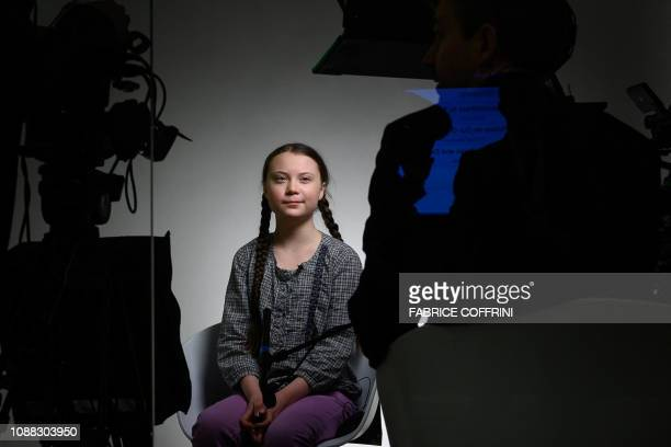 Swedish youth climate activist Greta Thunberg smiles during a TV interview at the World Economic Forum annual meeting on January 25 2019 in Davos...