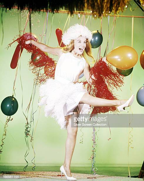 SwedishAmerican actress AnnMargret dancing among colourful balloons and streamers circa 1963