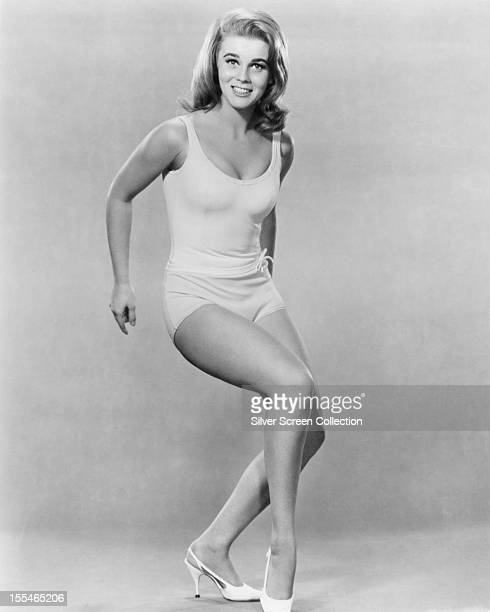 SwedishAmerican actress AnnMargret in shorts a sleeveless top and high heels circa 1963