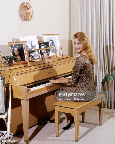 SwedishAmerican actress AnnMargret playing a piano circa 1964