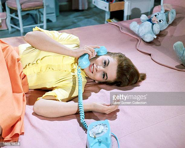 Swedish-American actress Ann-Margret using a Bell Princess telephone in a promotional portrait for 'Bye Bye Birdie', directed by George Sidney, 1963.