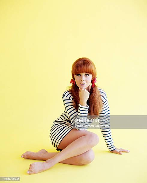 SwedishAmerican actress AnnMargret wearing a striped minidress and with her hair in bunches circa 1965