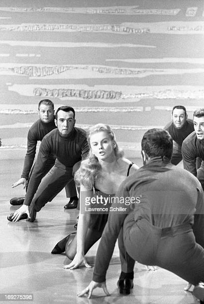 Swedishborn American actress AnnMargret along with unidentified extras dance in a scene from the film 'Bye Bye Birdie' Los Angeles California 1963