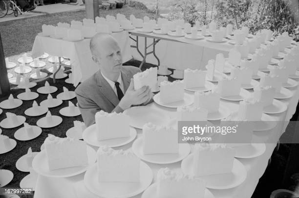 Swedishborn artist Claes Oldenburg arranges plaster cake slices Topanga Canyon California late April 1966 The pieces were created for the wedding Jim...